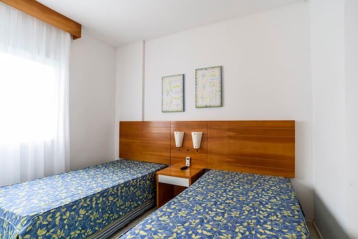 Suite 2 camas de solteiro, podendo ser unidas