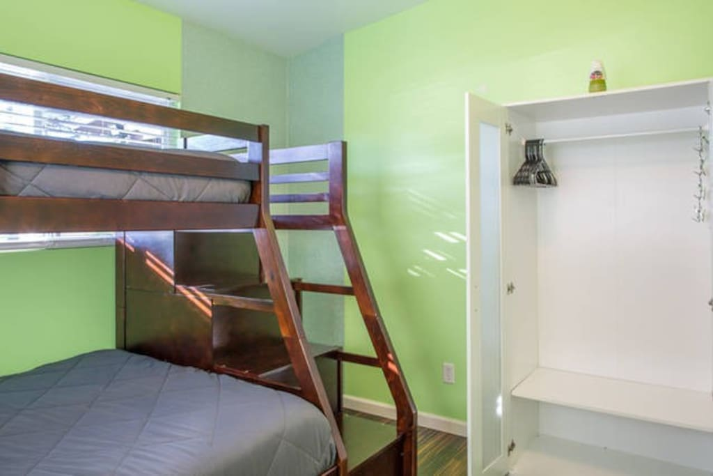 Bunk bed with closet in side the room