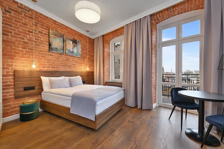 Krzywa Kamienica-Studio typu superior 5 z balkonem