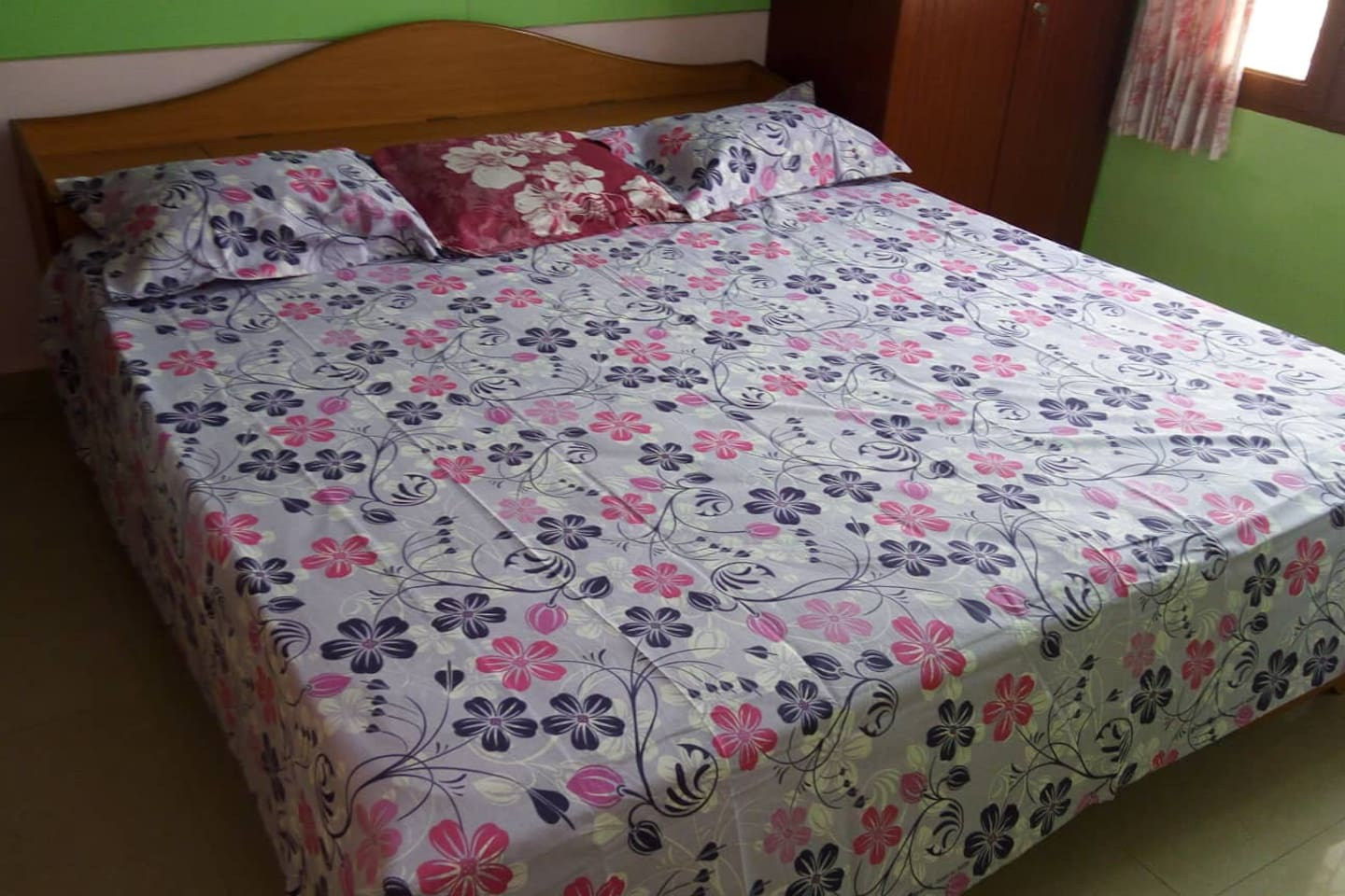 Jumbo sized bed for extra comfort. Room is very spacious with an attached bath.