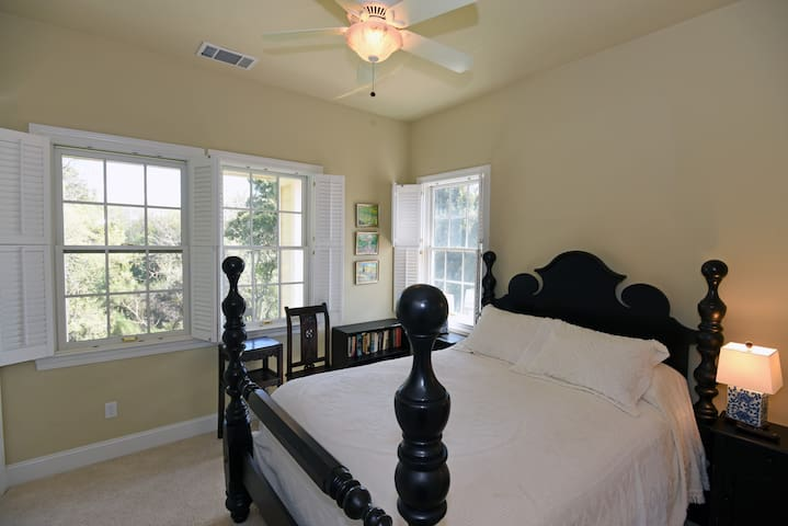 Suisun Creek Suite - Second floor facing creek and sunrise.  Queen poster bed.  Flat screen TV.  Shares Jack & Jill bathroom with Twin Sisters Suite.