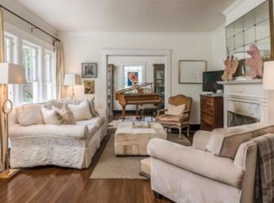Large, bright living room with a sofa-you'll-never-want-to-leave that is the size of a twin bed.