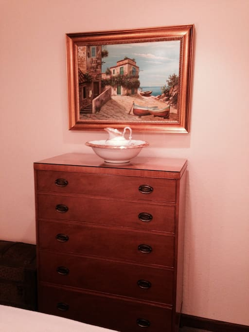 Bedroom 1: This beautiful painting was sent to us directly from Sicily.