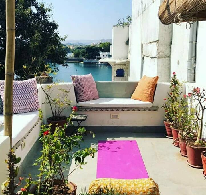 Yoga on the private roof terrace overlooking Pichola Lake.