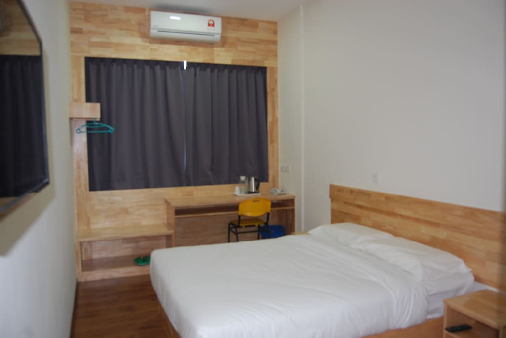 Spacious Room,  with basic room amenities such as TV (flat), air conditioning,  free WiFi connection plus all highly standard bathroom equipment.