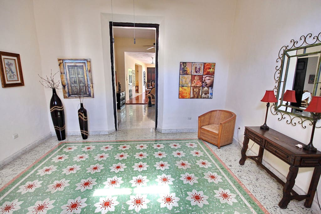 Welcome to Casa Paraiso.  The colonial style entrance with beautiful Spanish pasta tile floors are a warm invitation to the home.  From here you can see the living and dining rooms.