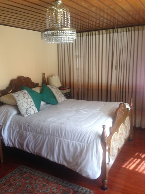 Double bed with tv and attached private bath