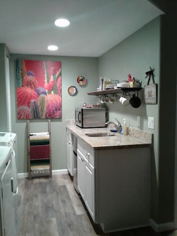 Kitchenette includes new small refrigerator, coffee maker, toaster, small crockpot, all utensils, glasses, plates and microwave, washer and dryer.