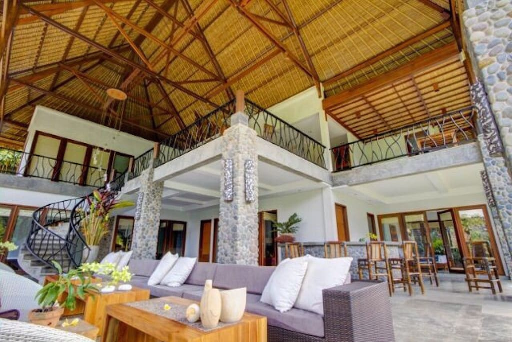 Enjoy the Great Room seating area under the 39 foot hand woven ceilings.