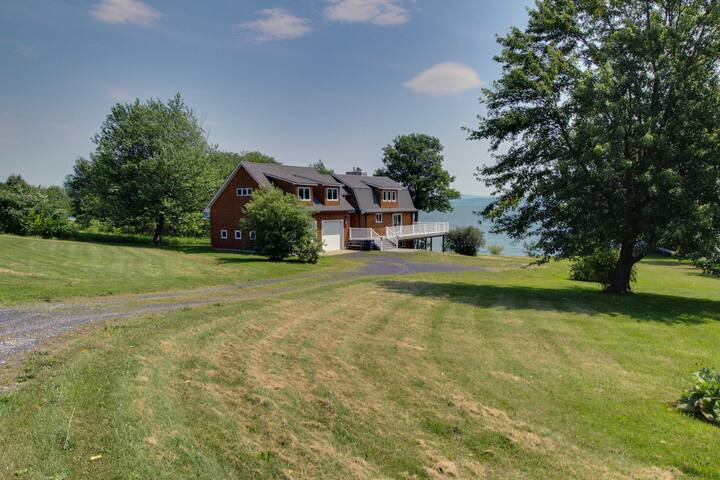 Find peace and tranquility at this expansive lakeside home