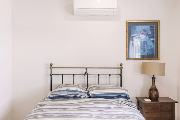 The second bedroom. All bedrooms have airconditioners, fans and opening windows.