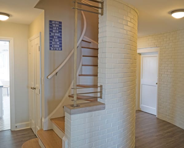 Spiral stairway to second floor master suites