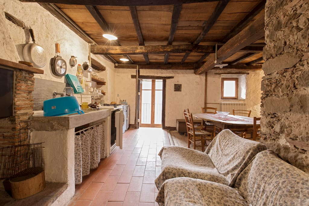 View of kitchen, dining room table, and door to the terrace