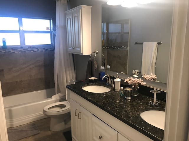 2nd full bath room with 2 sinks