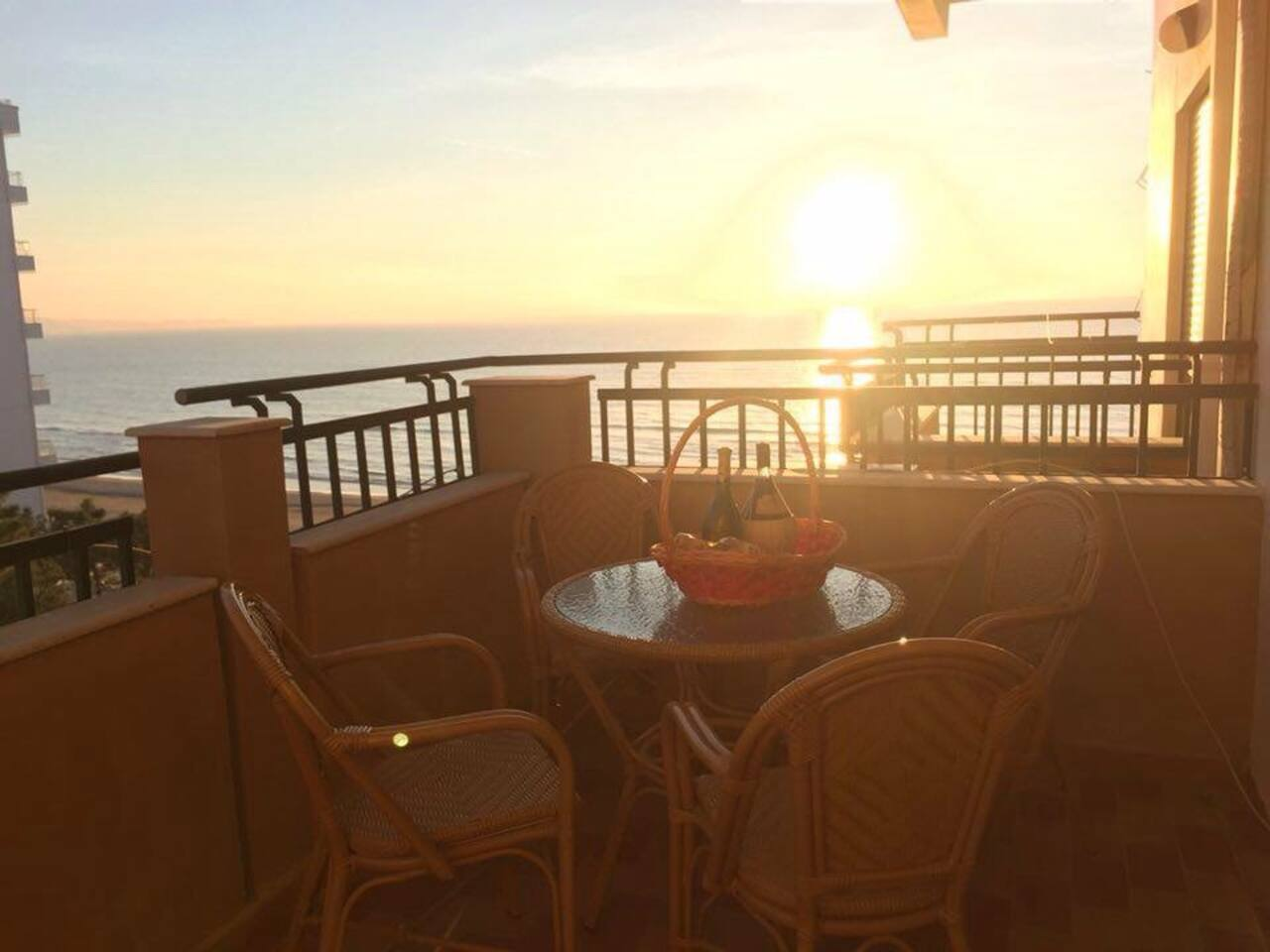 A glass of Albanian wine enjoying the golden sunset and the gorgeous view