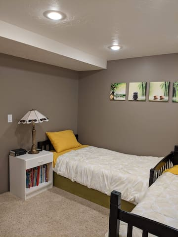 Bedroom #2, consists of 2 twin beds, a third high quality twin air mattress can be set up still with plenty of room left.