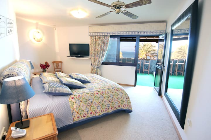 Master bedroom with King bed, ensuite WC and ocean views