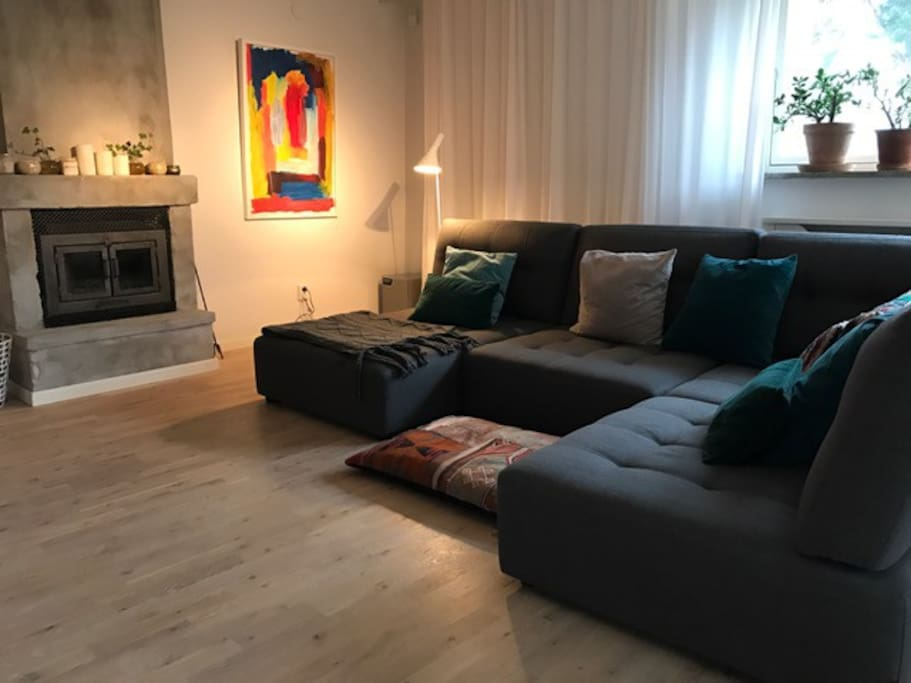 Comfy sofa with an open fire