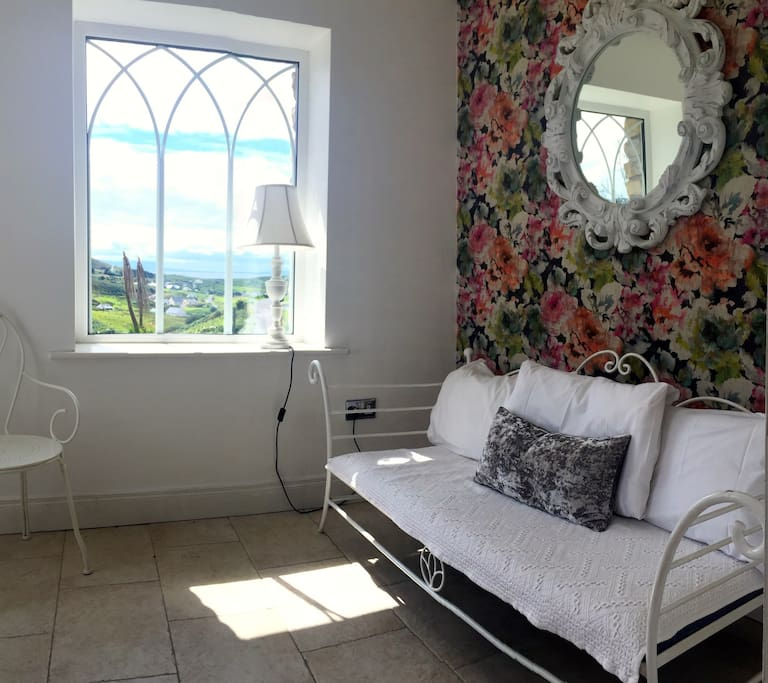 Inside the porch with views of the countryside and across the water towards Benbulben in Co. Sligo