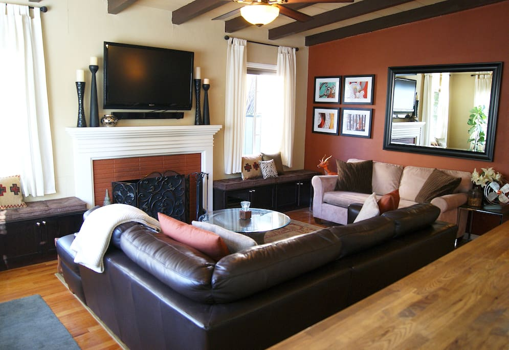 Living room with beamed ceiling, fireplace and TV