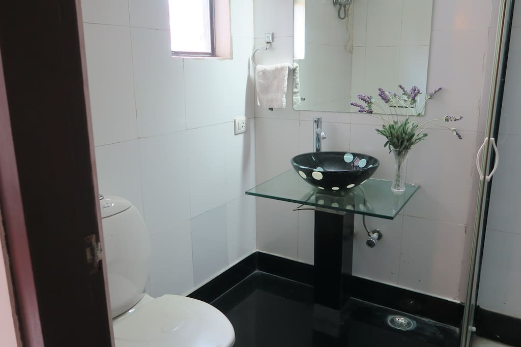 Attached bathroom with shower cubicle