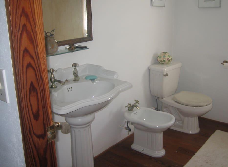 Shared, bright, clean bathroom.