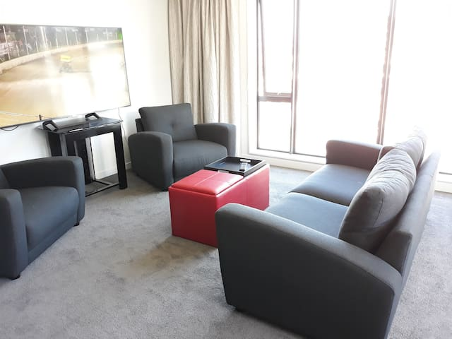 """Comfortable lounge with 55"""" TV"""