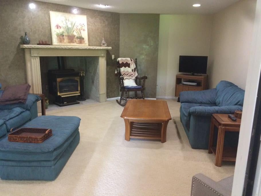 Comfortable living room with gas stove for supplemental heat and ambience!