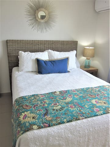 Guest bedroom with a queen size bed