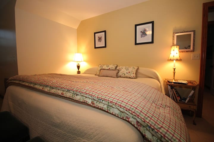 King size bed in upstairs bedroom