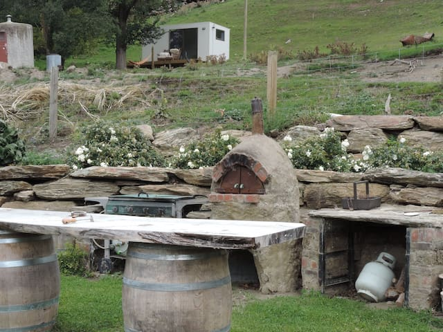 Enjoy outdoor dining, BBQ, pizza oven
