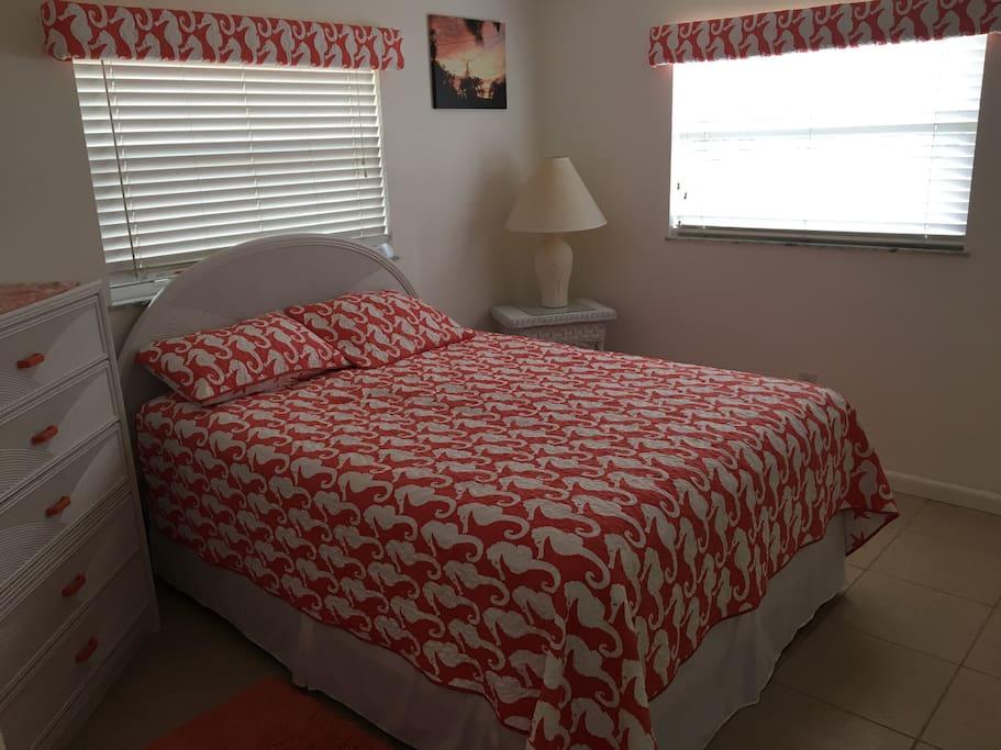 Queen bedroom with dresser, closet and TV