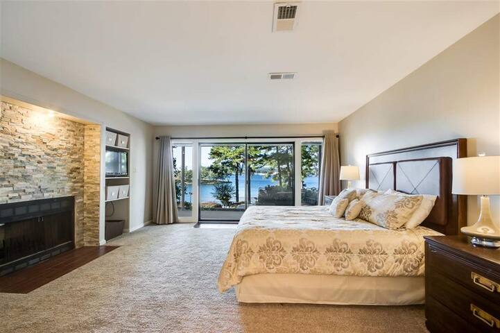 Downstairs master-has bathroom off the side and sliding glass doors opening up to bottom balcony