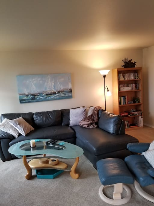Open concept. Living area. Remove back cushion for 2 more sleeping places.