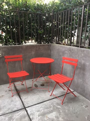 Cafe table and chairs in private courtyard