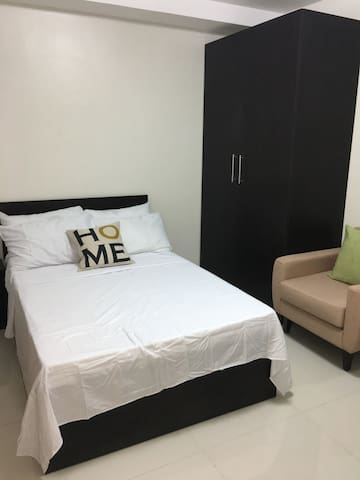 * Double bed - bed frame with mattress, fitted sheet and flat sheet * 4 pillows with pillowcases * Wardrobe cabinet * Upholstered accent chair  * 2 throw pillows with pillowcases