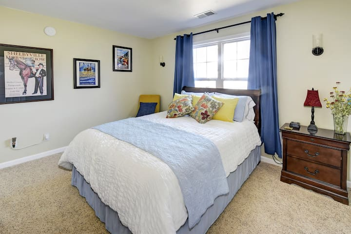 Guest bedroom with queen sized bed and trundle bed.  Kentucky themed decor