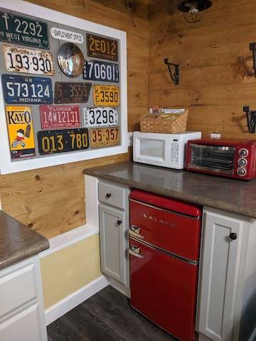 Guests have a small refrigerator with freezer, a toaster oven and microwave.