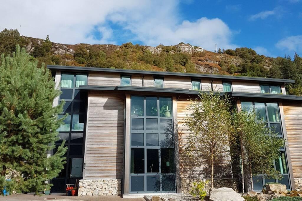 Stone, cedar wood and turf roof