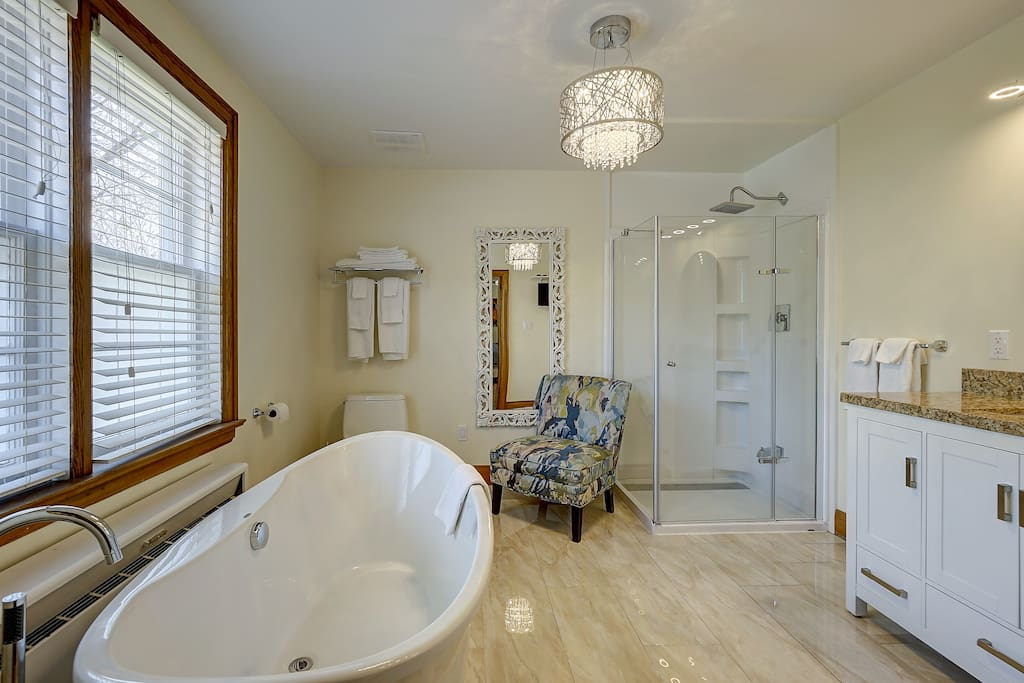 Luxury soaker tub with separate shower.