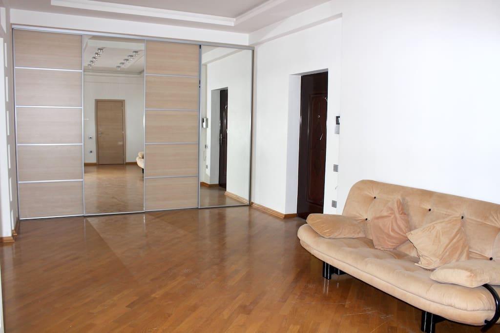 Hall - Entrance door, Big wardrobe and Sofa