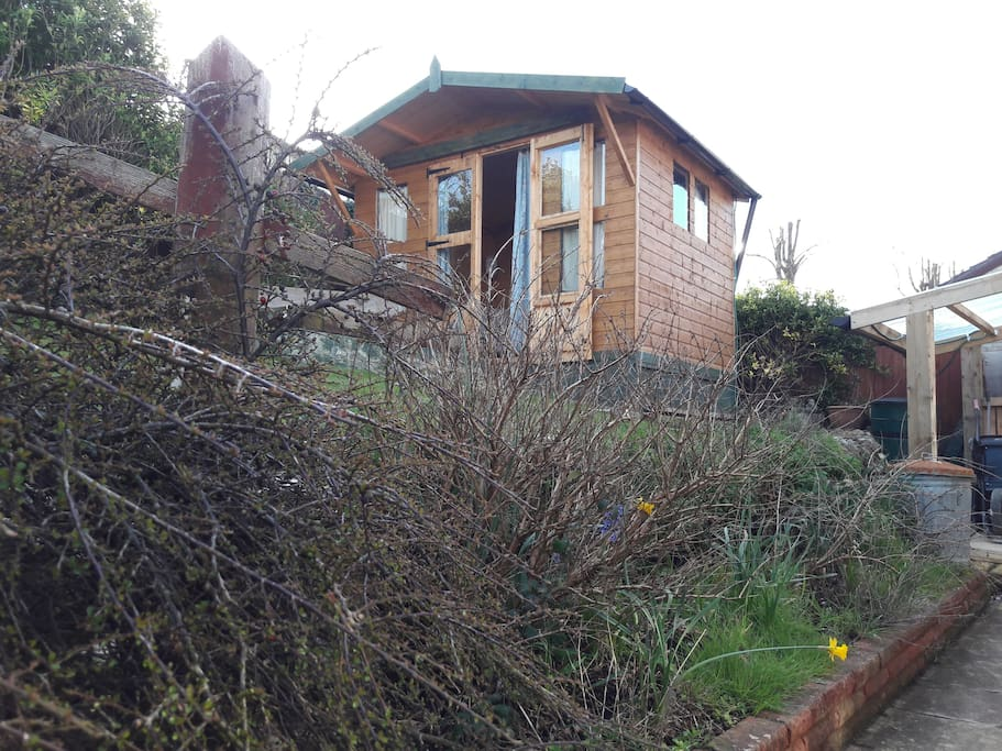 Large summer house with 2 chairs and a 6' bedsettee, plus patio and chairs