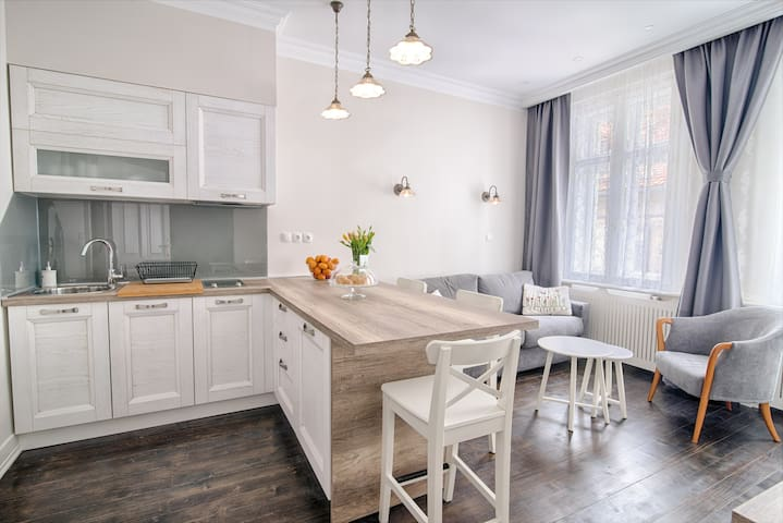 Fully equipped kitchen, living room and a private sleeping area.