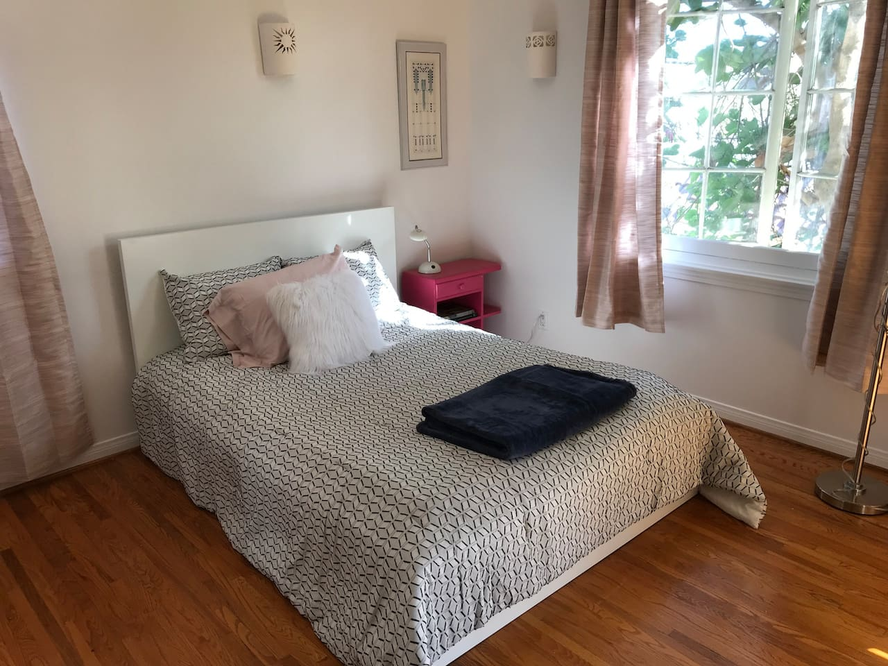 Light and airy private room with full size bed.