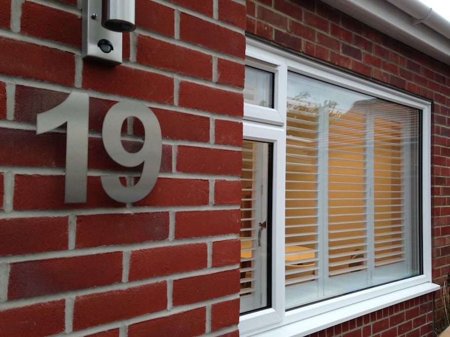 The annexe front window with plantation shutters