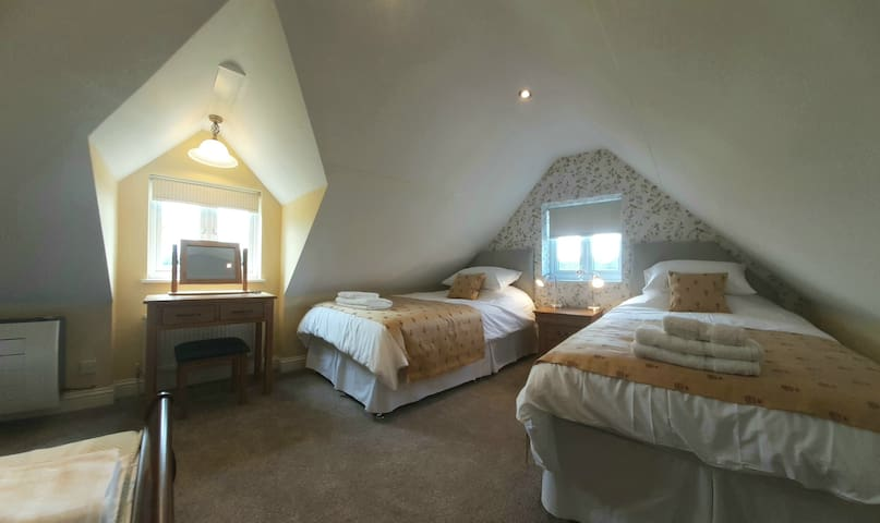 Bedroom 4  -  Large Singles with South and West views.