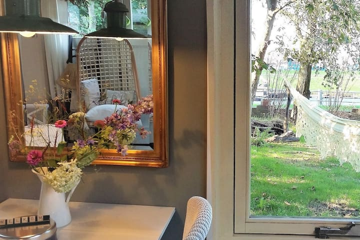 Cosy diner with fresh picked flowers from our yard. A View (on both sides)! In the orchard garden; your relaxing Family Hammock (and other seatings) is waiting for you