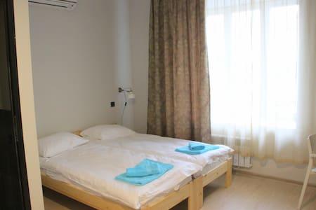 Двухместная комната в новом хостеле - Vologda