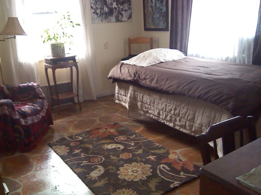 Sunny room with single bed, desk, chair, closet space