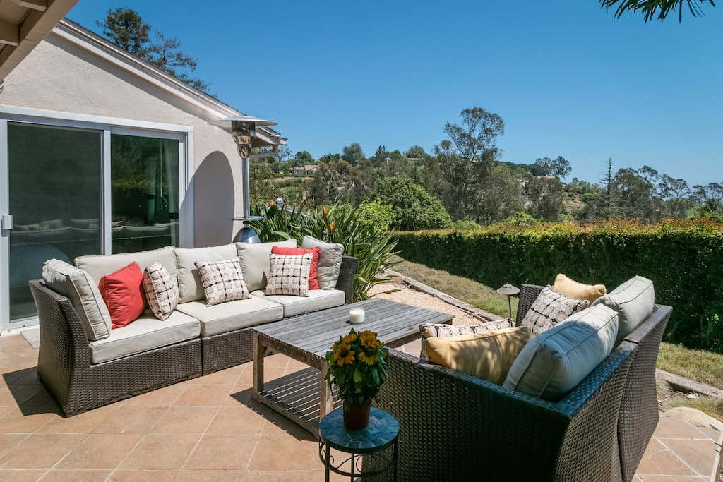 Cozy outdoor furniture promises pure relaxation on the patio.